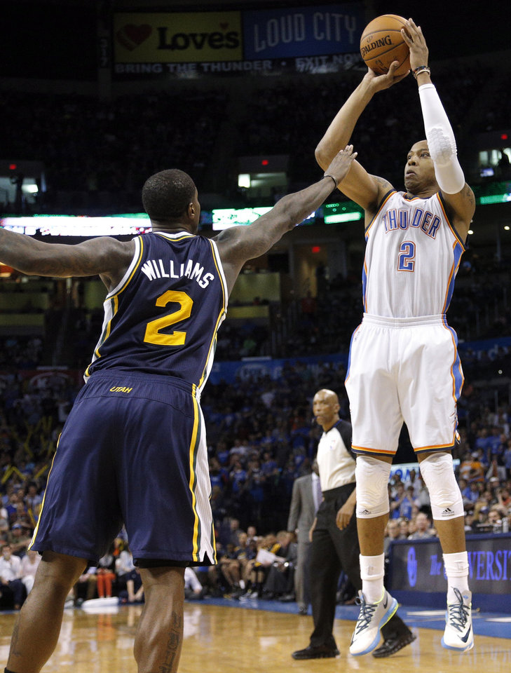 Photo - Oklahoma City 's Caron Butler (2) shoots over Utah's Marvin Williams (2) during the NBA game between the Oklahoma City Thunder and the Utah Jazz at the Chesapeake Energy Arena, Sunday, March 30, 2014, in Oklahoma City. Photo by Sarah Phipps, The Oklahoman