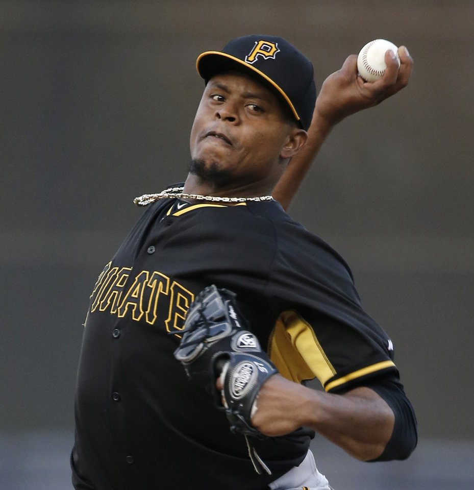 Photo - Pittsburgh Pirates starting pitcher Edinson Volquez (36) delivers a warmup pitch before facing the New York Yankees in a spring exhibition baseball game in Tampa, Fla., Friday, March 21, 2014.  (AP Photo/Kathy Willens)