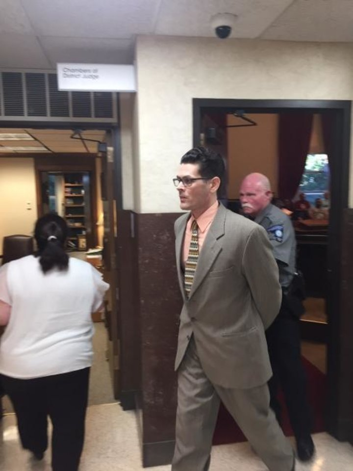 Photo -  Ronald McMullen is led away from a courtroom after jurors convicted him of first-degree murder in his daughter's shooting death. [Tim Willert/The Oklahoman]