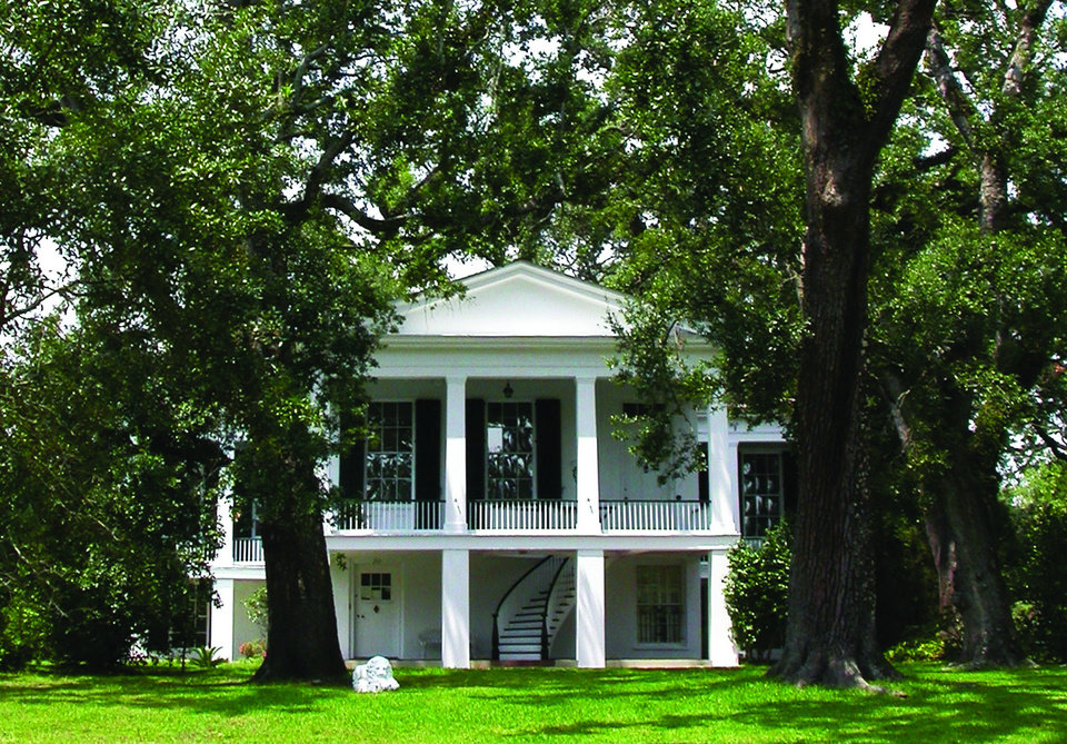 Photo - This undated photo provided by the Mobile Convention & Visitors Bureau shows a home in the Oakleigh historic district of Mobile, Alabama. The neighborhood features scores of majestic homes dating to the 1800s and early 1900s. (AP Photo/Mobile CVB)