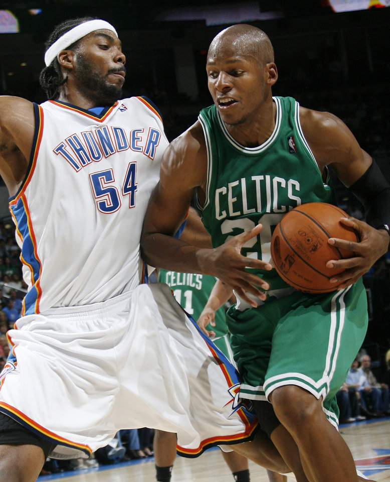 Photo - Boston's Ray Allen tries to get past Chris Wilcox of the Thunder in the second half during the NBA basketball game between the Oklahoma City Thunder and the Boston Celtics at the Ford Center in Oklahoma City, Wednesday, Nov. 5, 2008. Boston won, 96-83. BY NATE BILLINGS, THE OKLAHOMAN