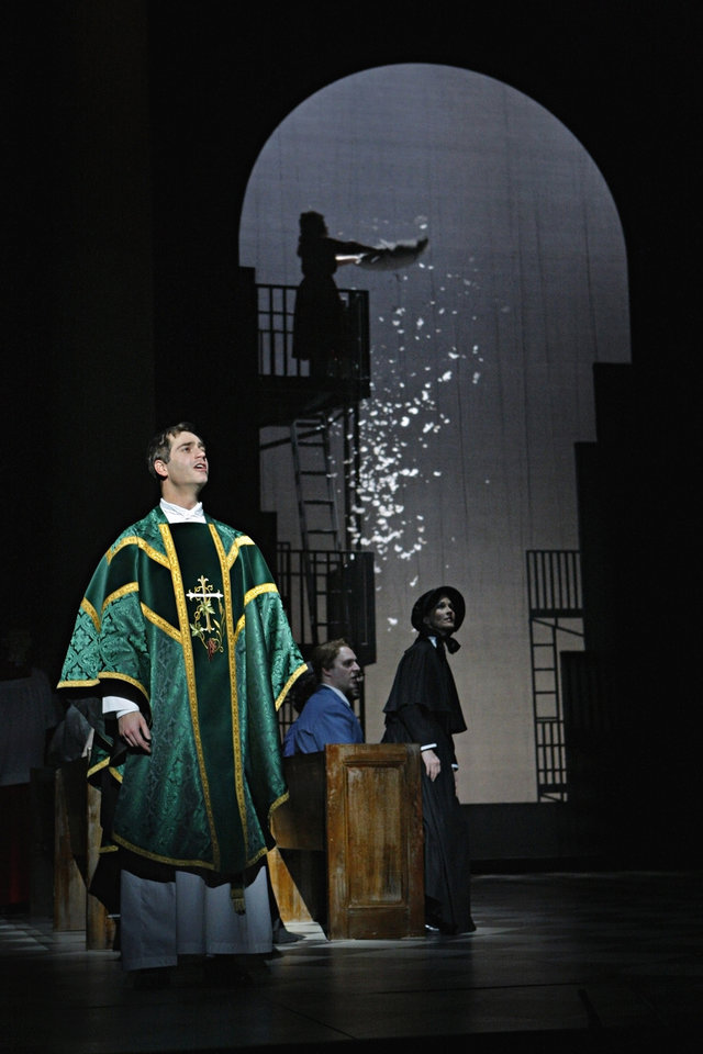 In this Jan. 23, 2013 photo provided by the Minnesota Opera, Matthew Worth as Father Brendan Flynn, a parish priest, performs during a dress rehearsal for the Jan. 26 world premiere of