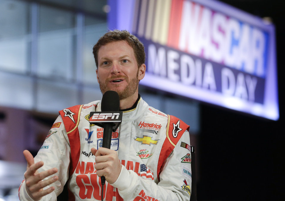 Photo - Driver Dale Earnhardt Jr. answers a question during a live TV interview at NASCAR auto racing media day at Daytona International Speedway in Daytona Beach, Fla., Thursday, Feb. 13, 2014. (AP Photo/John Raoux)