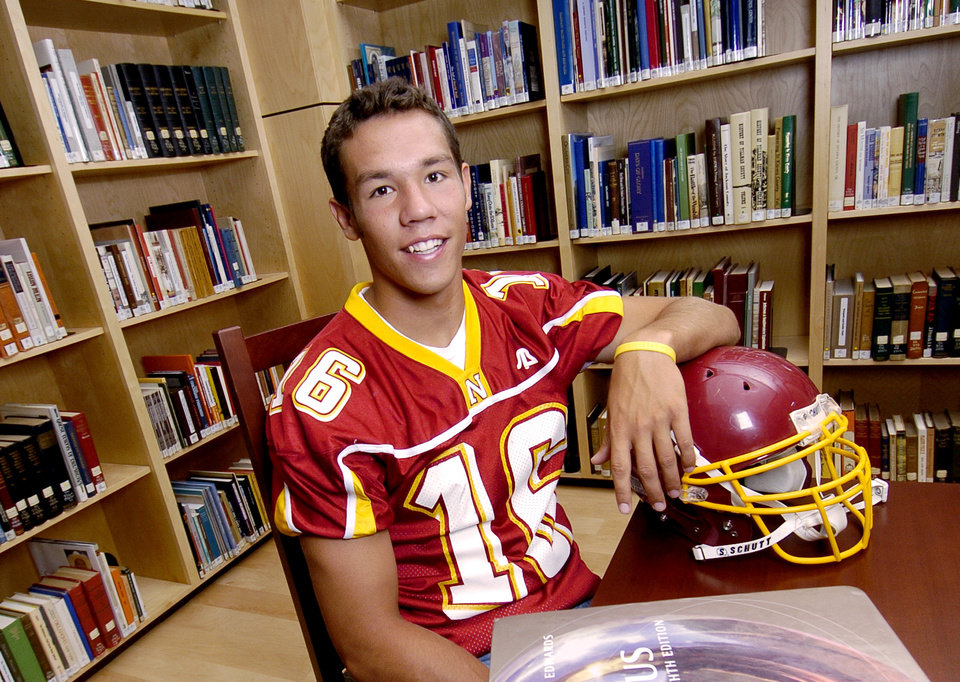 Photo - The Oklahoman male scholar-athlete of the year Sam Bradford of Putnam City North at the Ronald J. Norick Downtown Library in Oklahoma City June 3, 2006. By Matt Strasen, The Oklahoman