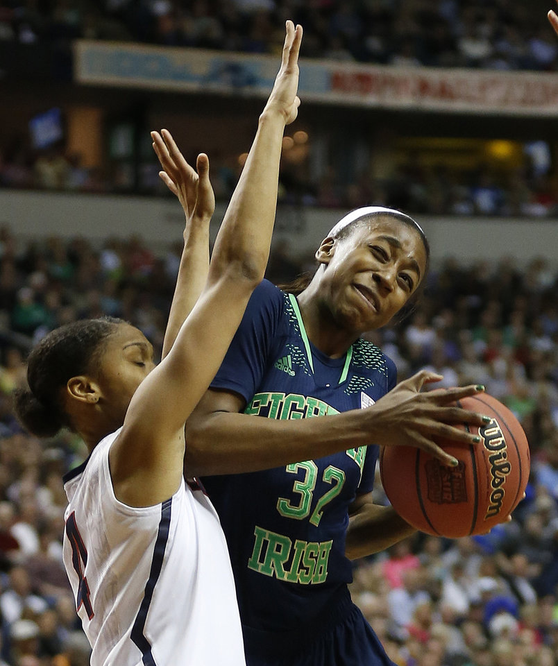 Photo - Notre Dame guard Jewell Loyd (32) collides into Connecticut guard Moriah Jefferson (4) during the first half of the championship game in the Final Four of the NCAA women's college basketball tournament, Tuesday, April 8, 2014, in Nashville, Tenn. (AP Photo/John Bazemore)