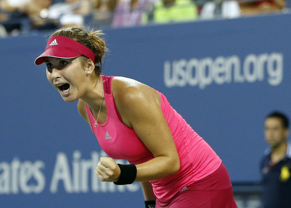 Photo - Belinda Bencic, of Switzerland, reacts on her way to her upset victory over Jelena Jankovic, of Serbia, in the fourth round of the 2014 U.S. Open tennis tournament, Sunday, Aug. 31, 2014, in New York. Bencic won 7-6 (6), 6-3. (AP Photo/Elise Amendola)