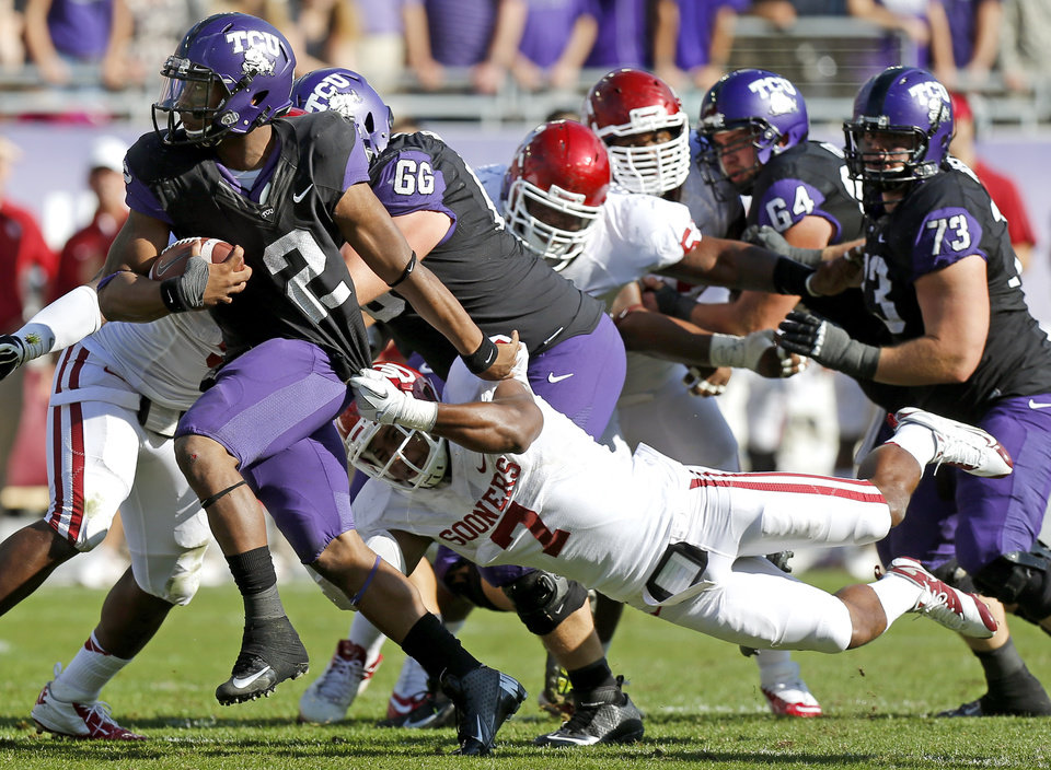Oklahoma's Corey Nelson (7) tries to bring down TCU's Trevone Boykin (2) during a college football game between the University of Oklahoma Sooners (OU) and the Texas Christian University Horned Frogs (TCU) at Amon G. Carter Stadium in Fort Worth, Texas, Saturday, Dec. 1, 2012. Oklahoma won 24-17. Photo by Bryan Terry, The Oklahoman