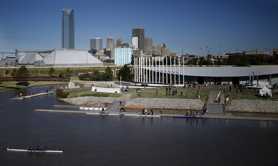 Photo - A team competes on the Oklahoma River during OCU Head of the Oklahoma & USRowing Masters National Head Race Championships, Sunday, Oct. 6, 2013, in Oklahoma City. Photo by Sarah Phipps, The Oklahoman