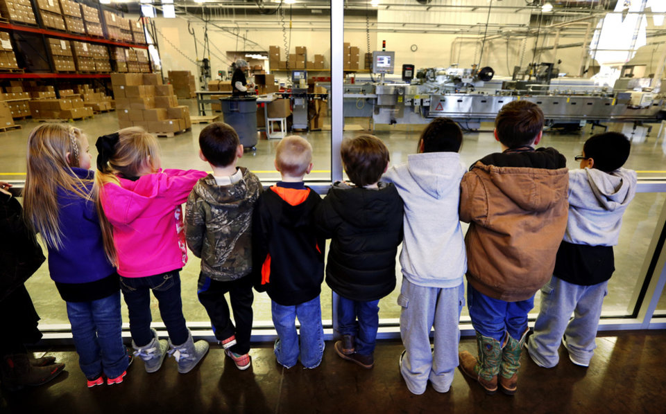 Photo -  A tour group of elementary schoolchildren watch the manufacturing process at Bedre Fine Chocolate on Friday in Davis. Photos by Steve Sisney, The Oklahoman   STEVE SISNEY -  THE OKLAHOMAN