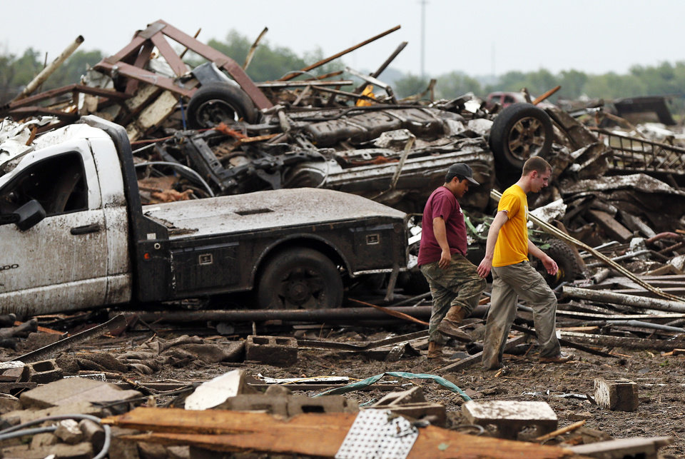 Two men walk through debris just east of Western and north of SW 149th after a tornado struck south Oklahoma City and Moore, Okla., Monday, May 20, 2013. Photo by Nate Billings, The Oklahoman