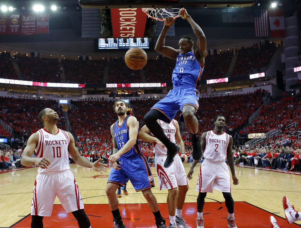 Photo - Oklahoma City's Jerami Grant (9) dunks the ball during Game 5 in the first round of the NBA playoffs between the Oklahoma City Thunder and the Houston Rockets in Houston, Texas,  Tuesday, April 25, 2017.  Houston won 105-99. Photo by Sarah Phipps, The Oklahoman