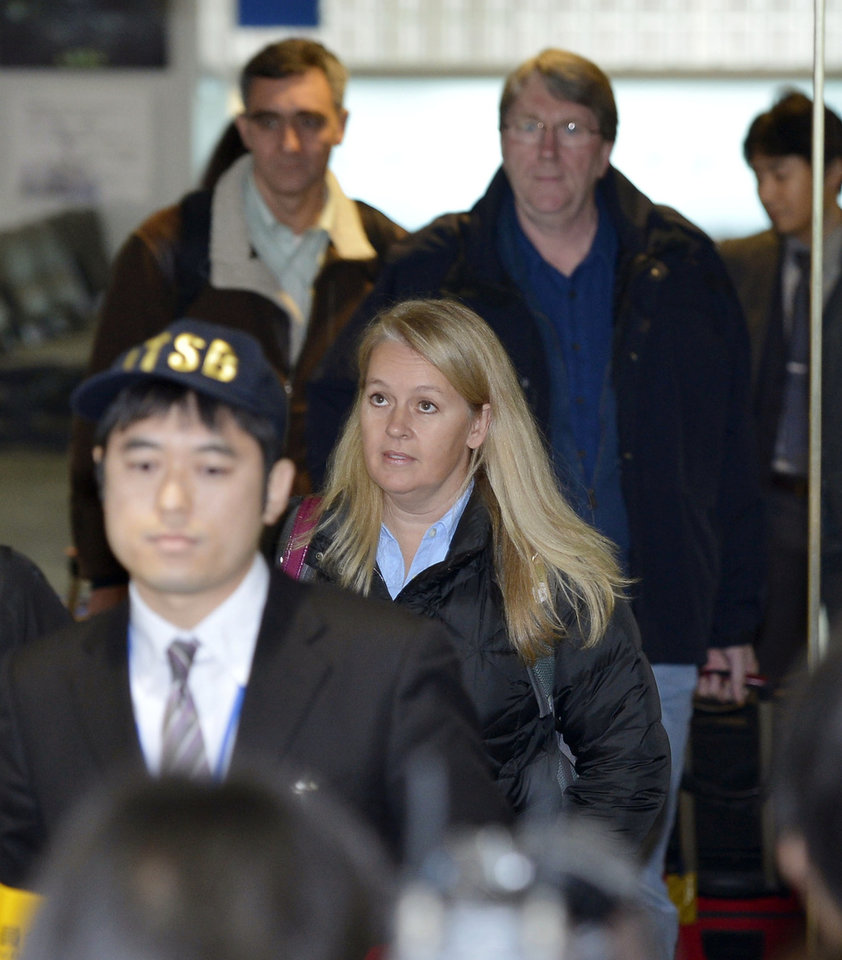 Representatives of the U.S. investigation team arrive at Takamatsu airport, to investigate an emergency landing of a Boeing 787 which exposed a battery fire risk in Takamatsu, western Japan, Friday, Jan. 18, 2013. Boeing, the U.S. National Transportation Safety Board and Federal Aviation Administration were sending representatives to work with the Japanese government on the investigation, NTSB spokeswoman Kelly Nantel said. (AP Photo/Kyodo News) JAPAN OUT, MANDATORY CREDIT, NO LICENSING IN CHINA, HONG KONG, JAPAN, SOUTH KOREA AND FRANCE
