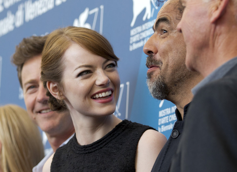 Photo - Actress Emma Stone, second from left, talks to director Alejandro Inarritu, second from right, as they pose during a photo call for the movie Birdman at the 71st edition of the Venice Film Festival in Venice, Italy, Wednesday, Aug. 27, 2014. (AP Photo/Andrew Medichini)