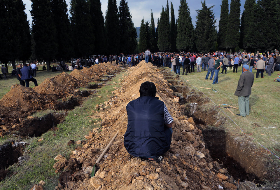 Photo - Rows of open graves for the mine accident victims are seen in Soma, Turkey, Wednesday, May 14, 2014. A violent protest erupted Wednesday in the Turkish city of Soma, where at least 238 coal miners have died after a mine explosion. Many in the crowd expressed anger at Prime Minister Recep Tayyip Erdogan's government. Rocks were being thrown and some people were shouting that Erdogan was a