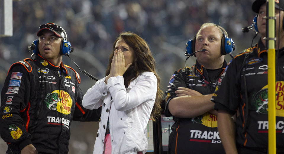 Photo -   Haley Carey, center, Ty Dillon's girlfriend, reacts as Dillon wrecks during the final laps of the NASCAR Nationwide Truck Series auto race on Friday, Nov. 16 2012, at Homestead-Miami Speedway in Homestead, Fla. (AP Photo/J Pat Carter)