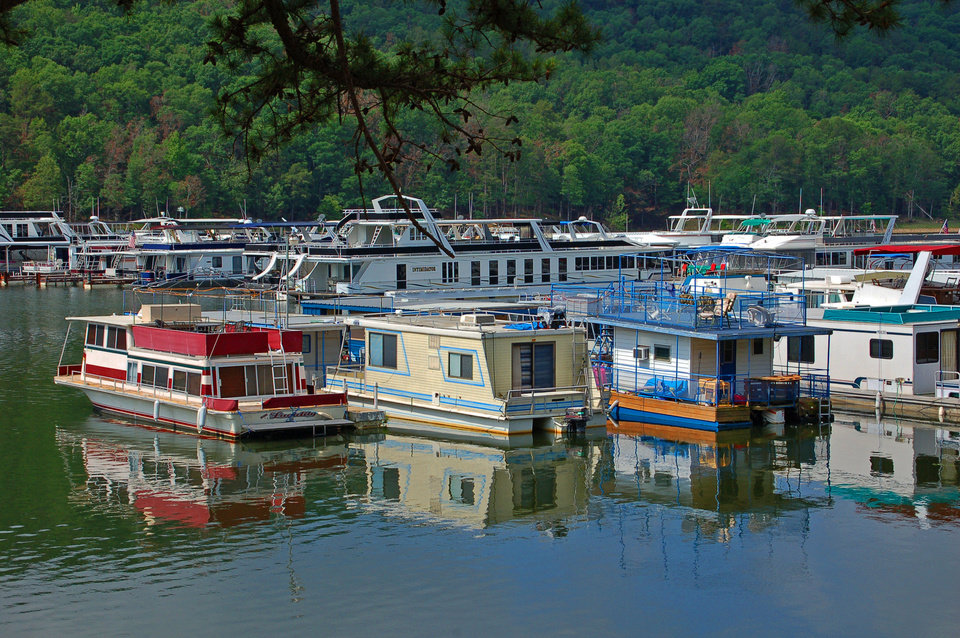 Photo - Boats are docked at the marina at Beavers Bend State Park in southeastern Oklahoma. PHOTOS PROVIDED