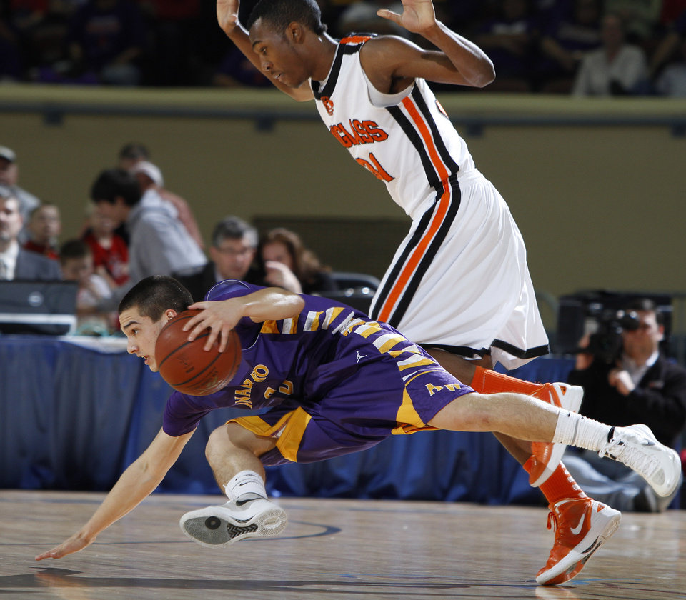 Photo - Anadarko's Tyler Melton falls to the ground in front of Dydrell Post of Douglass during the Class 4A boys high school state basketball championship game at State Fair Arena in Oklahoma City, Saturday, March 10, 2012. Photo by Bryan Terry, The Oklahoman