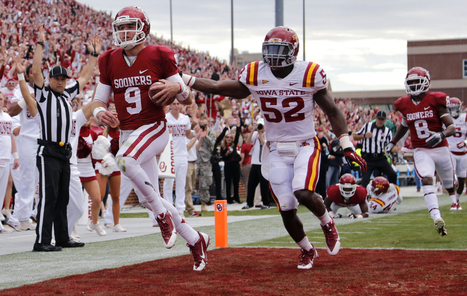 Oklahoma's Trevor Knight (9) runs past Iowa State's Jeremiah George (52) for a touchdown during the college football game between the University of Oklahoma Sooners (OU) and the Iowa State University Cyclones (ISU) at Gaylord Family-Oklahoma Memorial Stadium in Norman, Okla. on Saturday, Nov. 16, 2013. Photo by Chris Landsberger, The Oklahoman