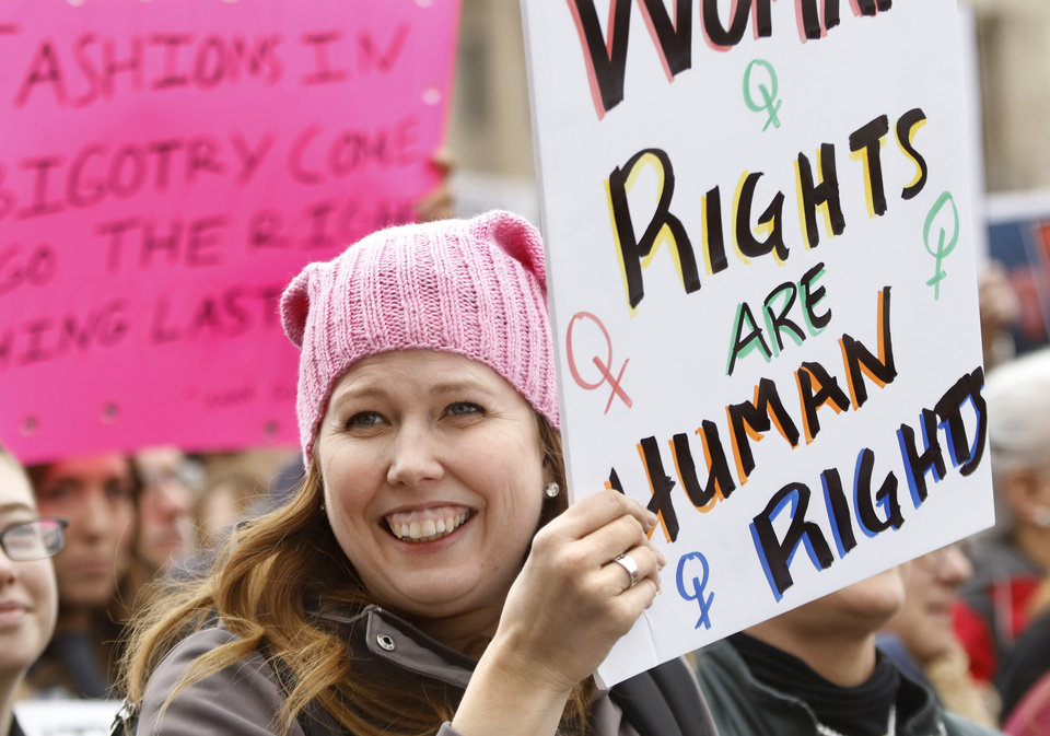 "Photo - A woman holds a sign that reads,  ""Woman's Rights Are Human Rights."" A crowd estimated by organizers to be as many as 7,000 people came to the state Capitol in Oklahoma City Saturday, Jan. 21, 2017, to rally, using their voices and signs to express displeasure with the nation's new administration as part of a larger network of marches taking place across the country following Donald Trump's inauguration.   The Women's March on Oklahoma included a walk along Lincoln Blvd., with the Capitol as a backdrop, and a rally on the Capitol's south plaza that featured nearly a dozen speakers.  Photo by Jim Beckel, The Oklahoman"