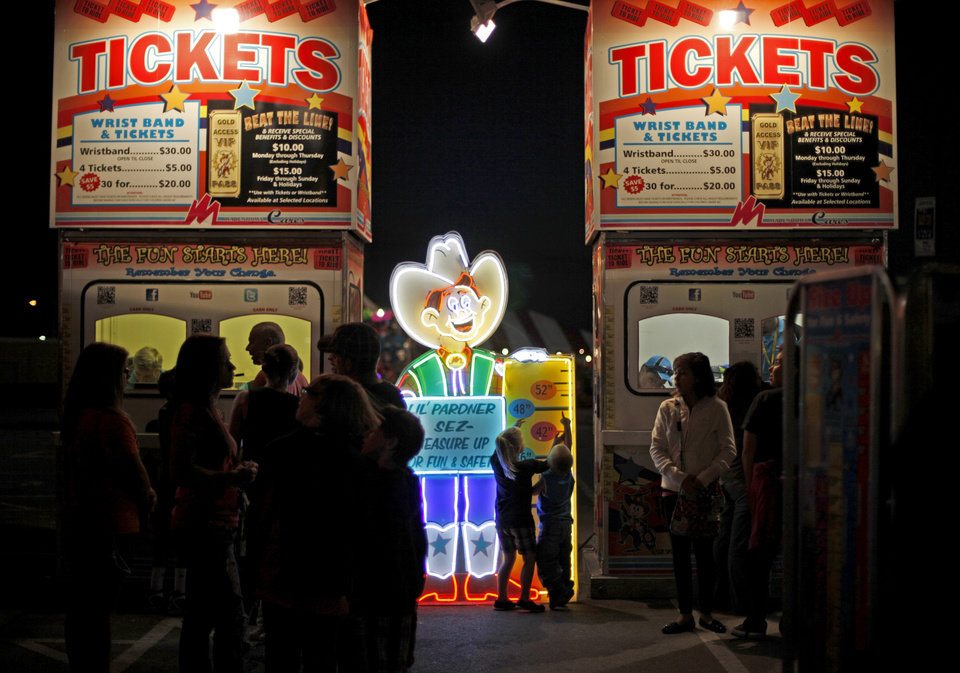 A crowd lines up for tickets after sunset at the Oklahoma State Fair in Oklahoma City, Wednesday, September 19, 2012. Photo by Bryan Terry, The Oklahoman