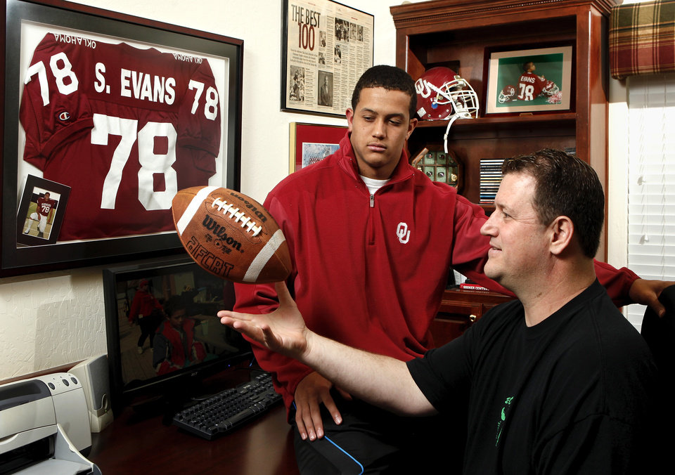 Photo - Former OU football player Scott Evans and his son, Jordan, who hopes to get a scholarship offer from the Sooners sometime soon, are photographed in the family's home in Norman on Saturday, Jan. 26, 2013.     Photo by Jim Beckel, The Oklahoman