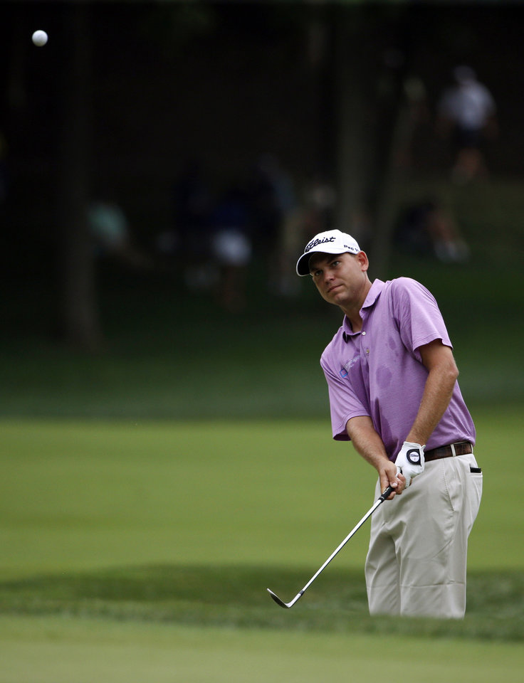 Photo - Bill Haas hits from rough on the second hole during the third round of the PGA Championship golf tournament at Valhalla Golf Club on Saturday, Aug. 9, 2014, in Louisville, Ky. (AP Photo/Mike Groll)