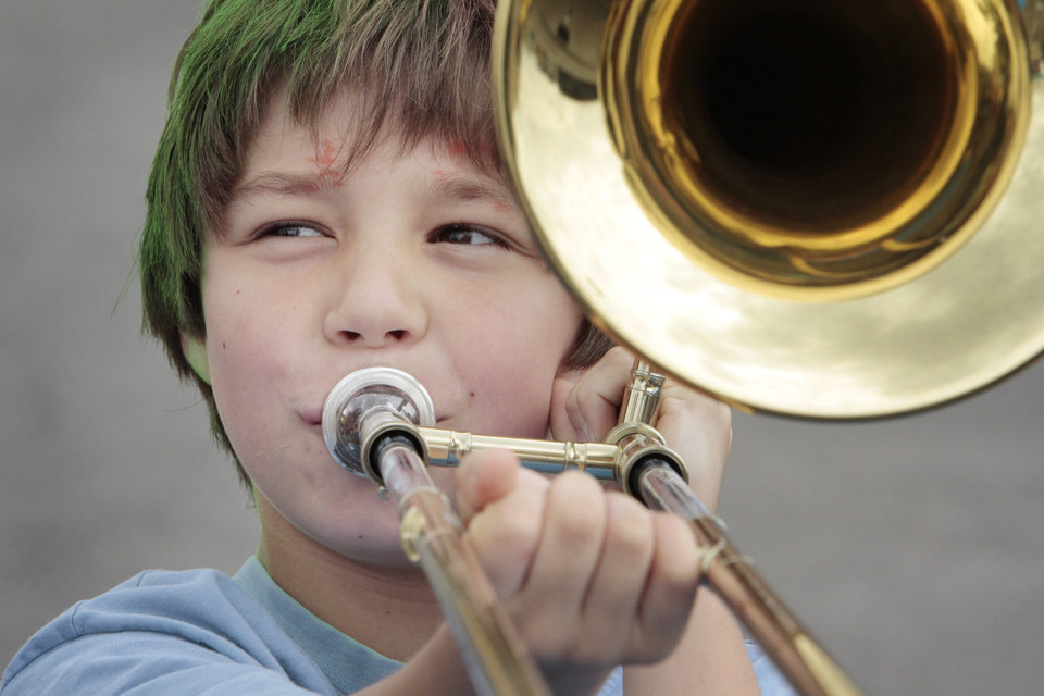 Liam Fithian, 9, gets to try out a trombone at the children's area during the Norman Music Festival on Saturday, April 28, 2012, in Norman, Okla.  Photo by Steve Sisney, The Oklahoman