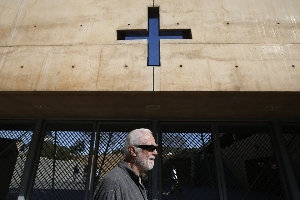 Photo - FILE - In this Jan. 22,2013 file photo alleged clergy abuse victim Ken Smolka walks past the Cathedral of Our Lady of the Angels after a news conference in Los Angeles. Cardinal Roger Mahony, who retired with a tainted career after dodging criminal charges over how he handled pedophile priests, was stripped of duties by his successor as a judge ordered confidential church personnel files released. (AP Photo/Jae C. Hong,File)