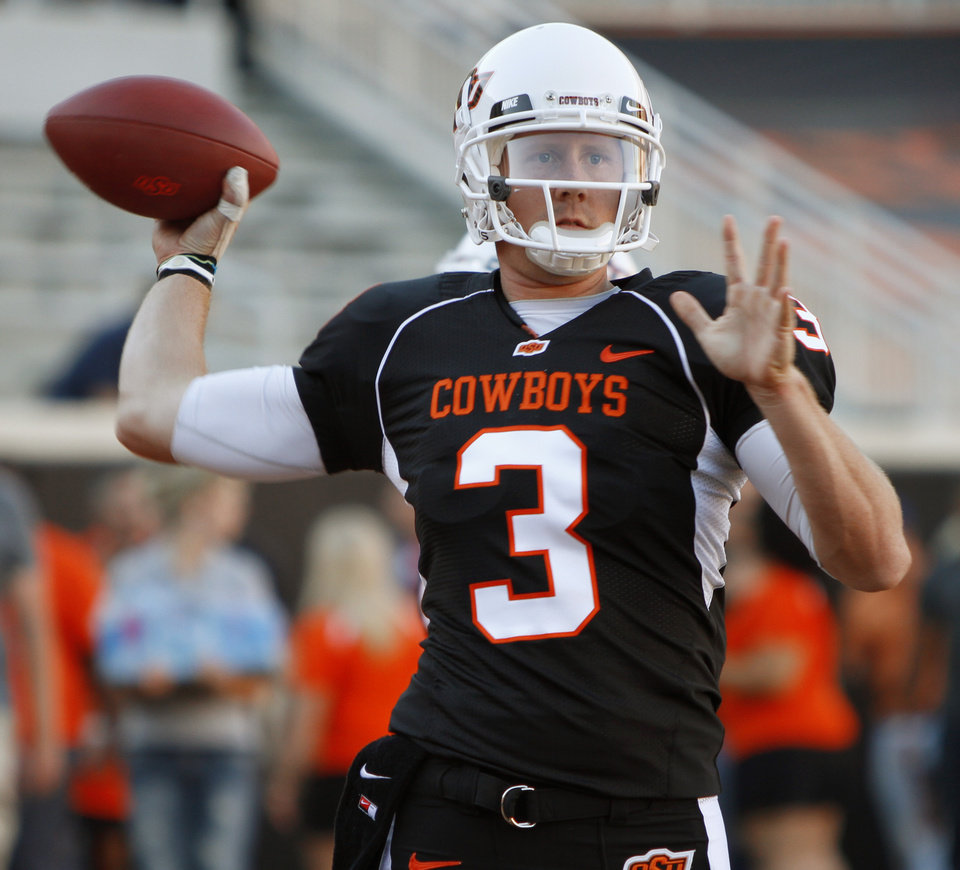 Photo - OSU's Brandon Weeden warms up before the college football game between Texas A&M University and Oklahoma State University (OSU) at Boone Pickens Stadium in Stillwater, Okla., Thursday, Sept. 30, 2010. Photo by Bryan Terry, The Oklahoman