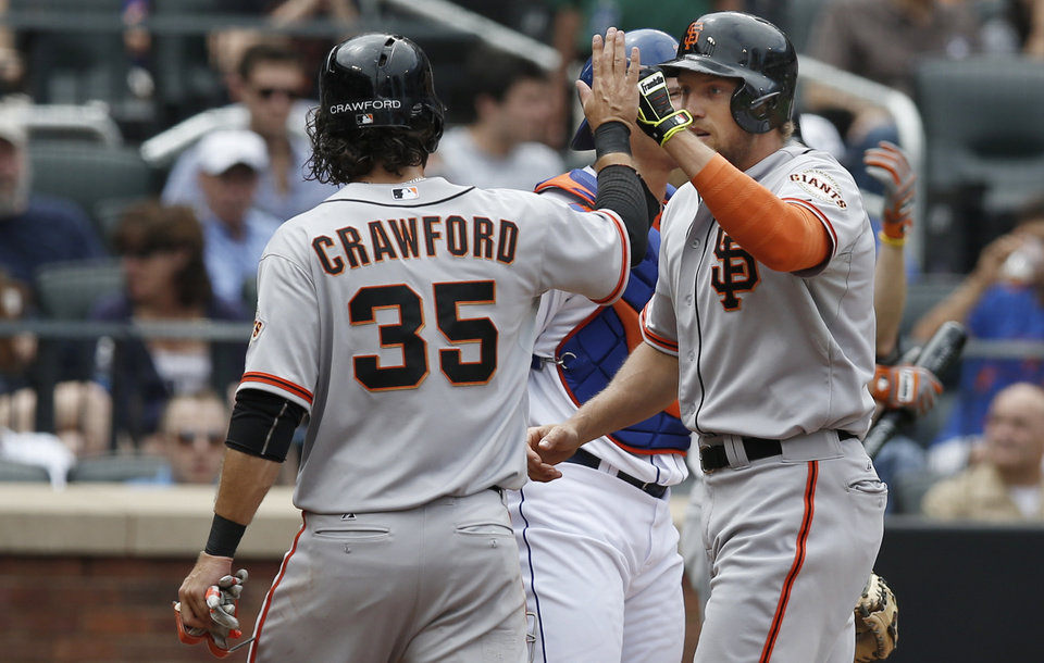 Photo - San Francisco Giants' Brandon Crawford (35) greets Giants' Hunter Pence at the plate after scoring on Pence's third-inning, two-run home run in a baseball game in New York, Sunday, Aug. 3, 2014. (AP Photo/Kathy Willens)
