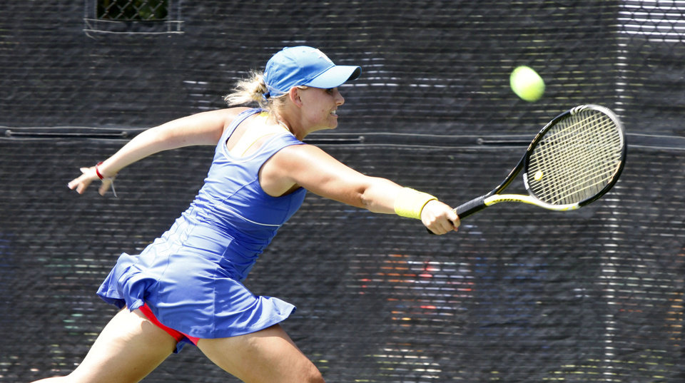 Photo - Heritage Hall's Sarah Bowen plays against Cascia Hall's Peyton Jennings in the 5A finals of the Girl's State Tournament at the Oklahoma Tennis Center in Oklahoma City, OK, Saturday, May 5, 2012,  By Paul Hellstern, The Oklahoman