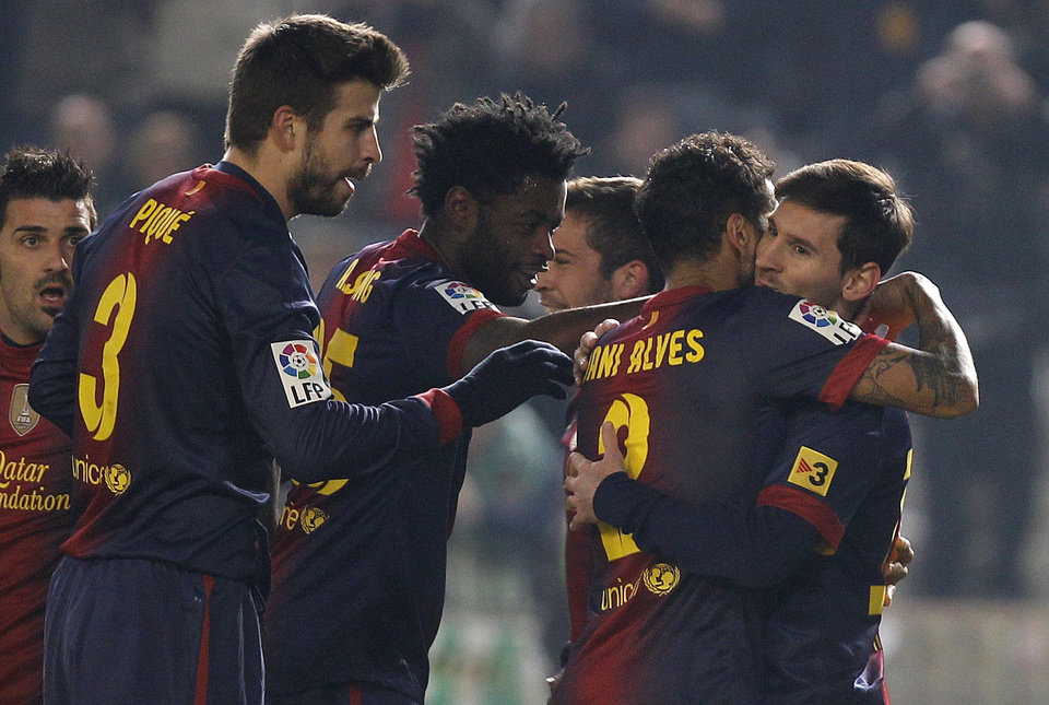 Barcelona\'s Lionel Messi, right, celebrates with teammates Daniel Alves, second right, Alexandre Song, second left, and Gerard Pique, left, after scoring against Cordoba during the 1st leg of a last-16 Copa del Rey soccer match at Arcangel stadium in, Cordoba, Spain on Wednesday, Dec. 12, 2012. (AP Photo/Angel Fernandez)
