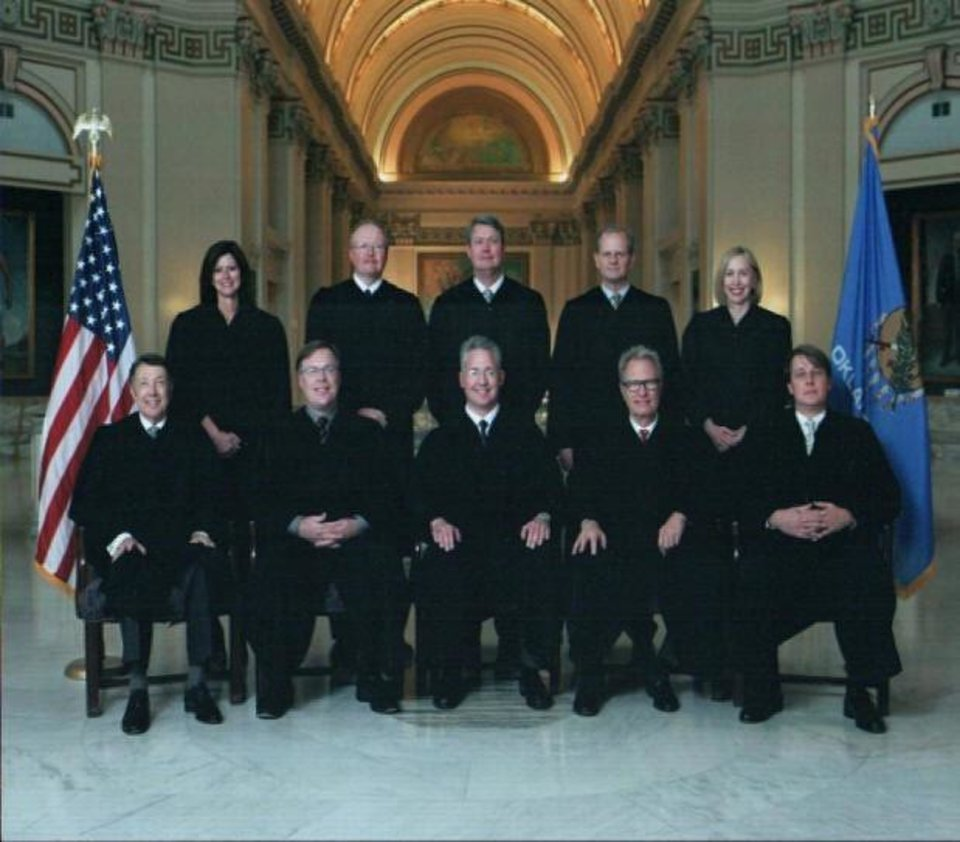 Photo - The 10 judges who serve on Oklahoma's Workers' Compensation Court are, front row from left, Bob Lake Grove, Eric W. Quandt, L. Brad Taylor, Michael J. Harkey and William R. Foster Jr., and, back row from left, Margaret A. Bomhoff, Owen T. Evans, Michael W. McGivern, David P. Reid and Carla Snipes. PHOTO PROVIDED