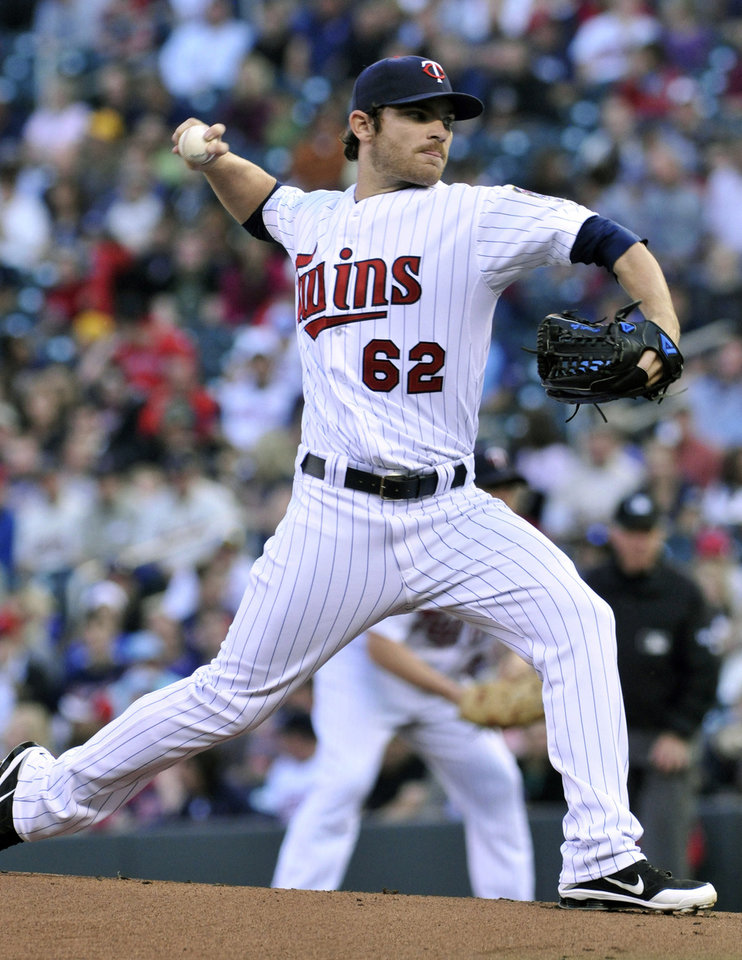 Photo -   Minnesota Twins pitcher Liam Hendriks throws to the Boston Red Sox in the first inning of a baseball game Wednesday, April 25, 2012, in Minneapolis. (AP Photo/Jim Mone)
