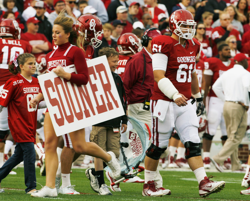 Oklahoma's Ben Habern (61), a captain, walks out for the coin toss before the college football game between the Texas A&M Aggies and the University of Oklahoma Sooners (OU) at Gaylord Family-Oklahoma Memorial Stadium on Saturday, Nov. 5, 2011, in Norman, Okla. Photo by Steve Sisney, The Oklahoman ORG XMIT: KOD