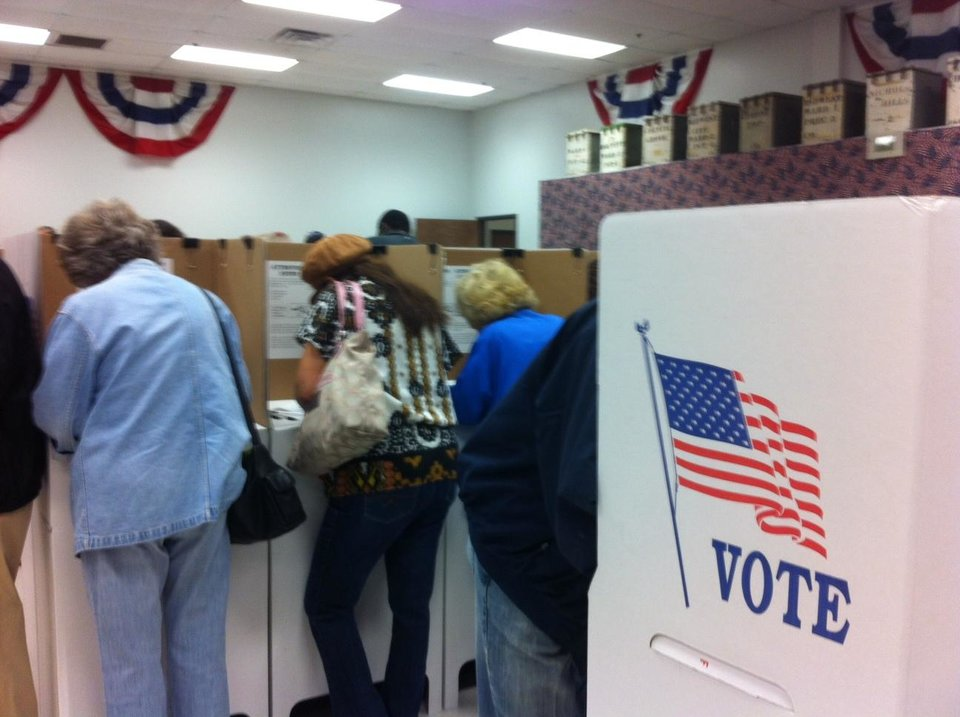Photo - People vote early at the Oklahoma County Election Board Friday morning. Photo by Robert Medley