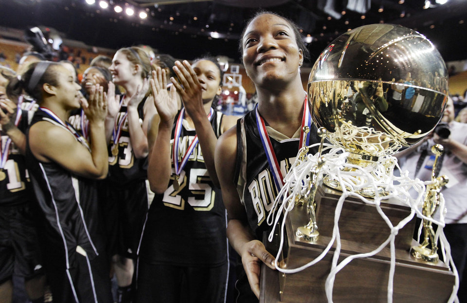 Photo - Midwest City's Richa Jackson (15) smiles as she holds the gold ball championship trophy after the Class 6A girls high school basketball state tournament final between Midwest City and Norman at the ORU Mabee Center in Tulsa, Okla., Saturday, March 13, 2010. Midwest City won, 46-32. Photo by Nate Billings, The Oklahoman