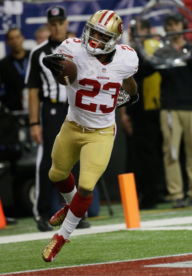 Photo - San Francisco 49ers' LaMichael James celebrates after rushing 15-yards for a touchdown during the first half of the NFL football NFC Championship game against the Atlanta Falcons Sunday, Jan. 20, 2013, in Atlanta. (AP Photo/Dave Martin)
