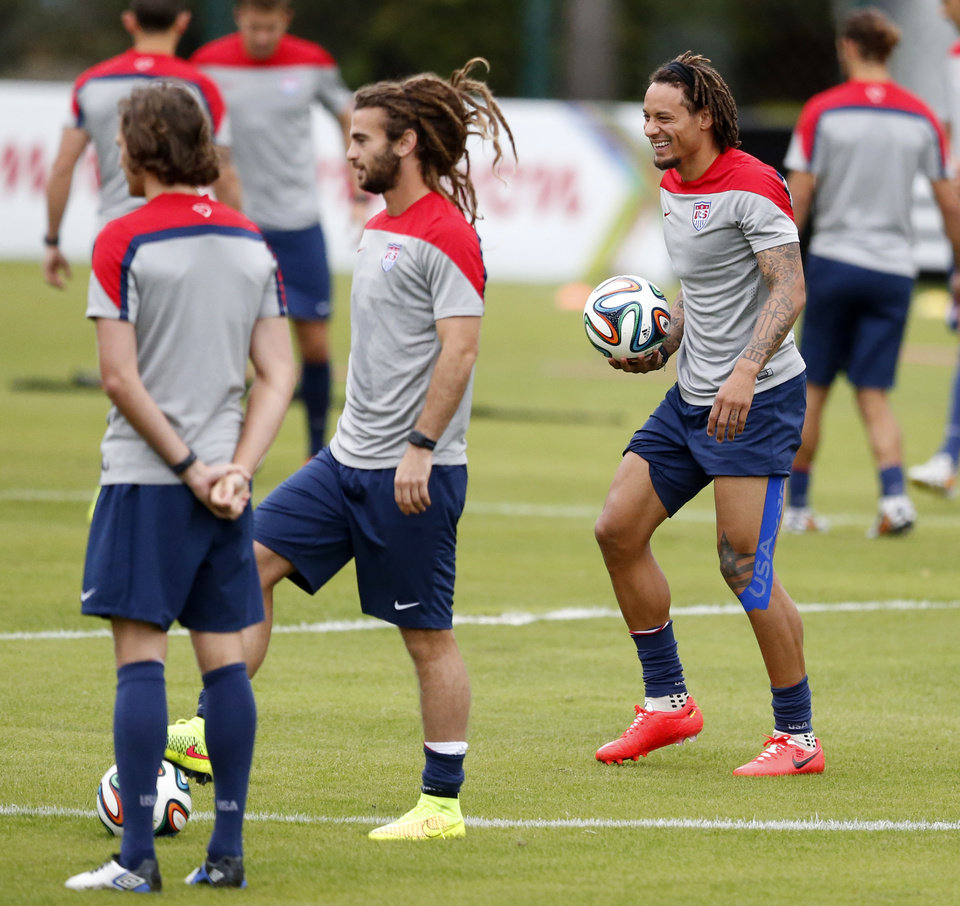 Photo - United States' Jermaine Jones jokes with teammates during a training session in Sao Paulo, Brazil, Thursday, June 19, 2014.  The United States will play against Portugal in group G of the 2014 soccer World Cup on June 22. (AP Photo/Julio Cortez)