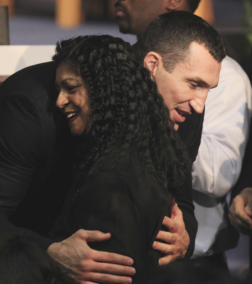 WBC Heavyweight Champion Vitali Klitschko hugs a member of the late boxing trainer Emanuel Steward\'s family at a funeral service for Steward at the Greater Grace Temple in Detroit, Tuesday, Nov. 13, 2012. (AP Photo/Carlos Osorio)