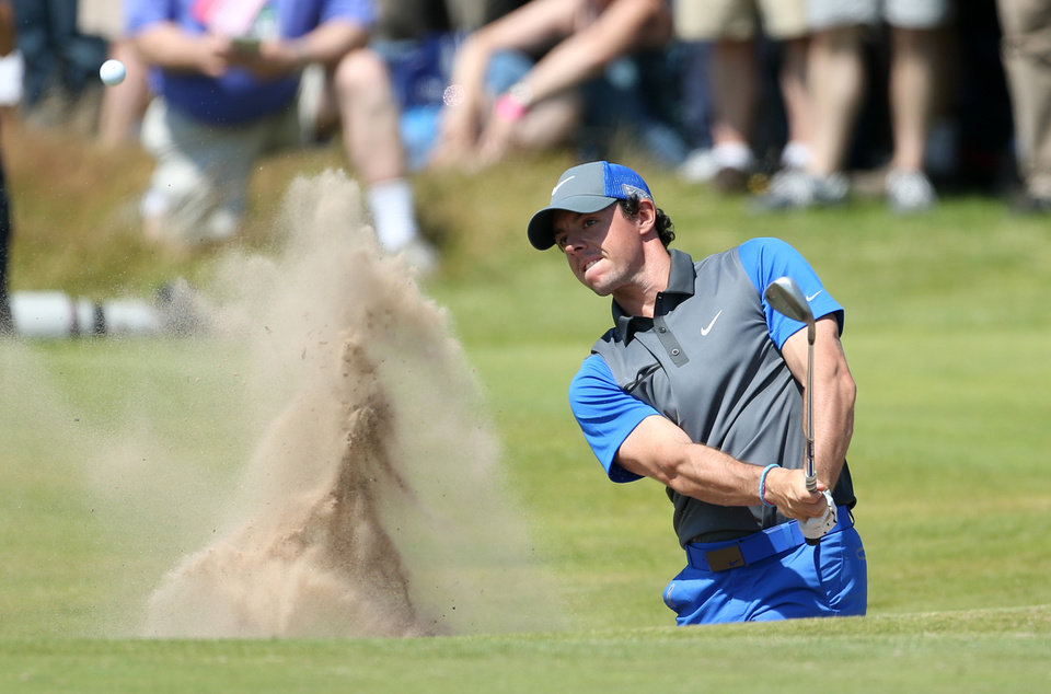 Photo - Rory McIlroy of Northern Ireland plays out of a bunker on the 16th hole during the first day of the British Open Golf championship at the Royal Liverpool golf club, Hoylake, England, Thursday July 17, 2014. (AP Photo/Peter Morrison)