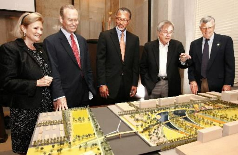 From left, Ward 6 Councilwoman Meg Salyer, Mayor Mick Cornett, Ward 7 Councilman Skip Kelly and Ward 4 Councilman Pete White look over a model of a proposed downtown park that is one of the centerpieces of the MAPS 3 plan.  PHOTO BY Jim Beckel, The Oklahoman