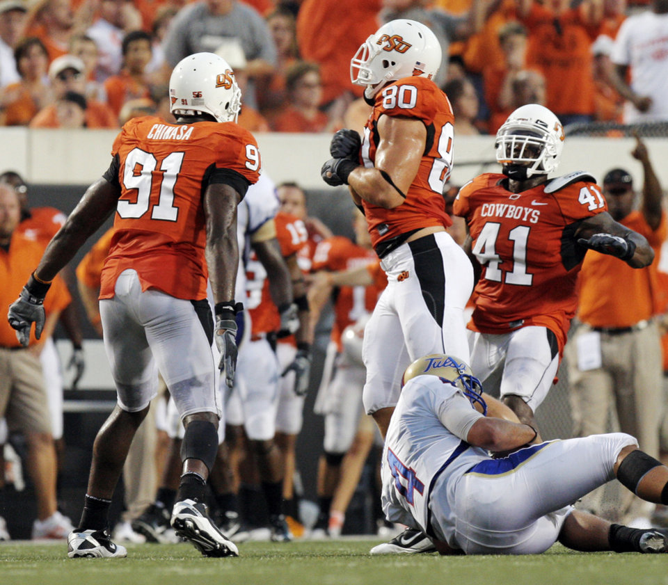 Photo - OSU's Ugo Chinasa (91), Cooper Bassett (80) and Orie Lemon (41) celebrate a sack of TU quarterback G.J. Kinne (4) by Bassett in the second quarter during the college football game between the University of Tulsa (TU) and Oklahoma State University (OSU) at Boone Pickens Stadium in Stillwater, Oklahoma, Saturday, September 18, 2010. Photo by Nate Billings, The Oklahoman