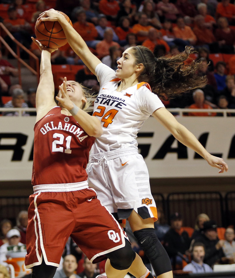 Photo -  Oklahoma State's Karli Wheeler (24) blocks a shot by Oklahoma's Gabbi Ortiz (21) during the Bedlam women's college basketball game between the Oklahoma State Cowgirls (OSU) and Oklahoma Sooners (OU) at Gallagher-Iba Arena in Stillwater, Okla., Saturday, Feb. 4, 2017. OU won 66-60. [PHOTO BY NATE BILLINGS, THE OKLAHOMAN]