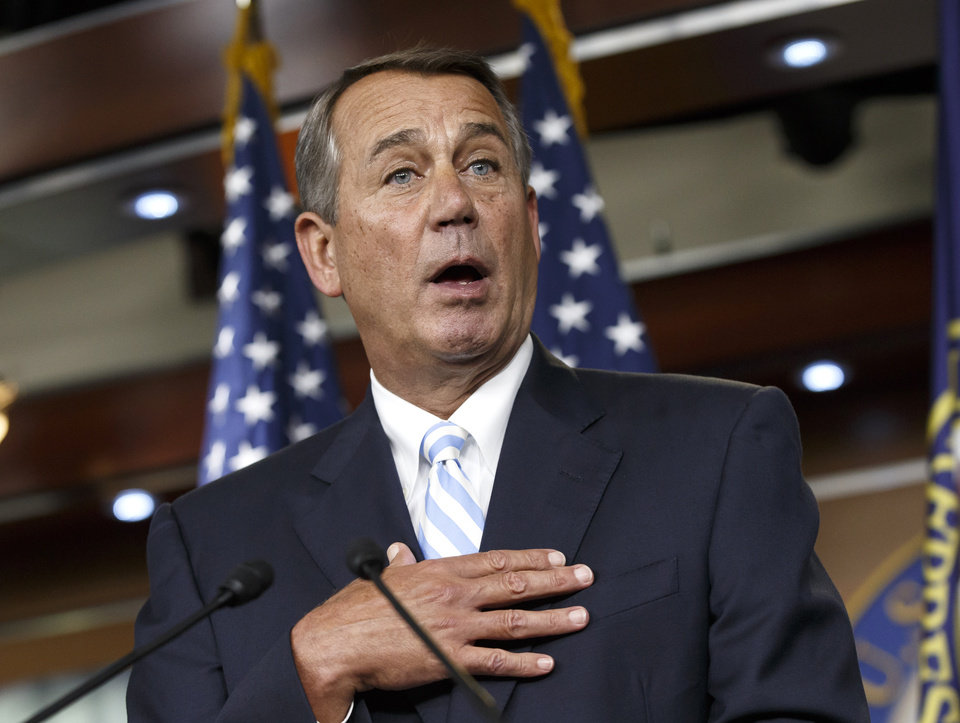 Photo - House Speaker John Boehner of Ohio defends the work of the GOP during a brief news conference on Capitol Hill in Washington, Thursday, July 31, 2014, as Congress prepares to leave for a five-week summer recess. The institutional split of a Republican-led House and Democratic-controlled Senate has added up to inaction, especially in a midterm election year with control of the Senate at stake. Lawmakers have struggled to compromise on a handful of bills to deal with the nation's pressing problems amid overwhelming partisanship.   (AP Photo/J. Scott Applewhite)