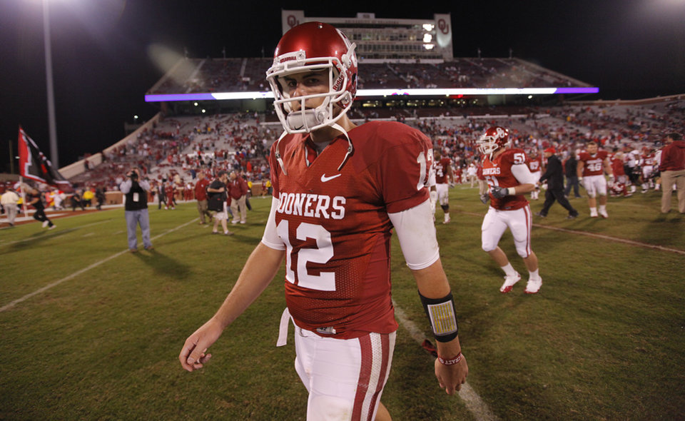Photo - Landry Jones walks off the field after the 41-38 loss to Texas Tech during the college football game between the University of Oklahoma Sooners (OU) and Texas Tech University Red Raiders (TTU) at the Gaylord Family-Oklahoma Memorial Stadium on Sunday, Oct. 23, 2011. in Norman, Okla. Photo by Chris Landsberger, The Oklahoman