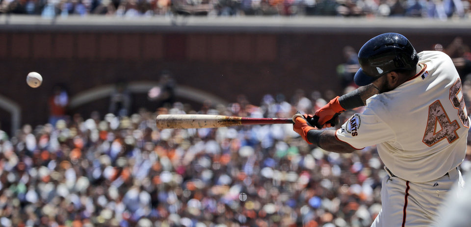 Photo - San Francisco Giants' Pablo Sandoval drives in a run with a single against the Chicago Cubs during the first inning of a baseball game on Monday, May 26, 2014, in San Francisco. (AP Photo/Marcio Jose Sanchez)