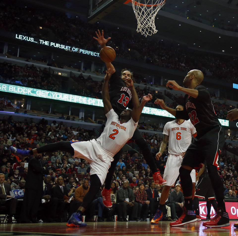 Photo - New York Knicks point guard Raymond Felton (2) has his shot blocked by Chicago Bulls center Joakim Noah (13) during the first half of an NBA basketball game on Sunday, March 2, 2014, in Chicago. (AP Photo/Jeff Haynes)