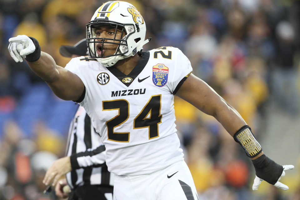 Photo - Missouri linebacker Terez Hall celebrates a tackle against Oklahoma State during the first half of the Liberty Bowl NCAA college football game in Memphis, Tenn., Monday, Dec. 31, 2018. (Joe Rondone/The Commercial Appeal via AP)