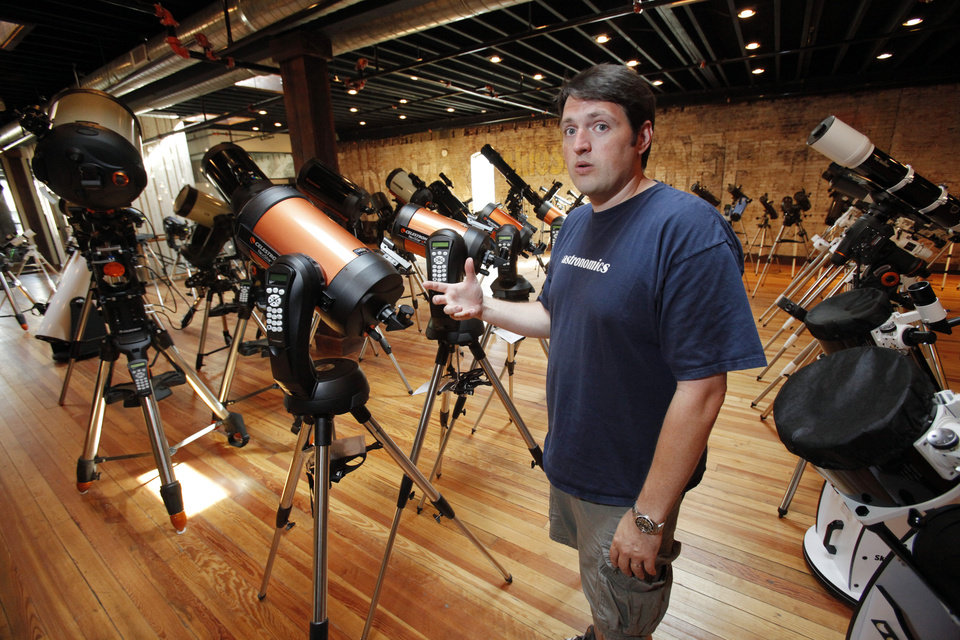 Mike Bieler, with Astronomics, stands in the second floor showroom on Tuesday, July 17, 2012 in Norman, Okla. The telescope specialty store recently moved to Main Street downtown giving it more showroom and retail space.  Photo by Steve Sisney, The Oklahoman